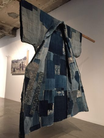 indigo dyed textile patched and mended